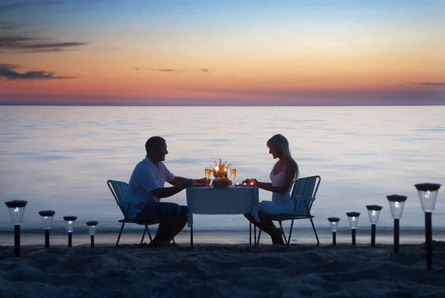 Couple having dinner on the beach