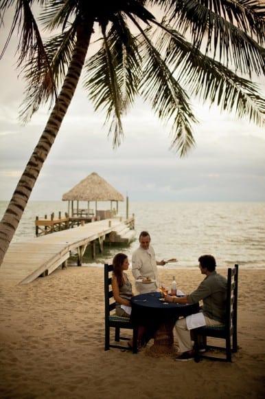 Couple having dinner on the beach