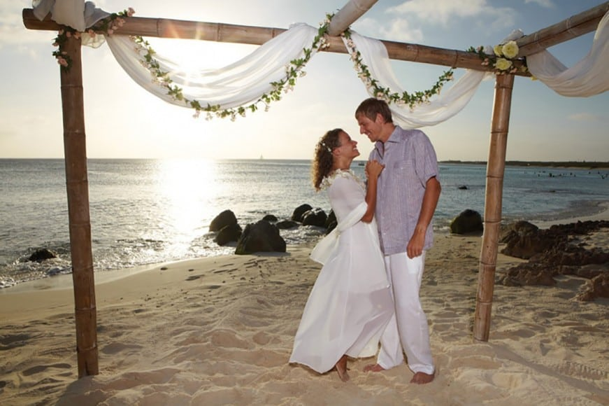 Destination wedding couple on beach in A