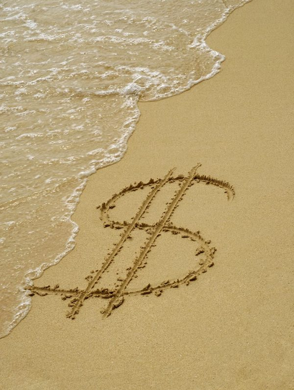 Dollar symbol in the sand